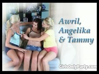 Busty lesbians enjoy a toying session