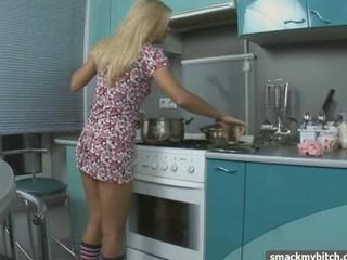 Blonde tease in kitchen