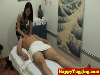 Asian Masseuse Tugging On Client Cock