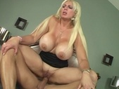 Blonde woman with huge mamaries sits on a cock