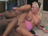 Big breasted woman playing with black dude