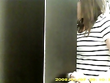 Dressing room hidden cam - Topless brunette with big boobs